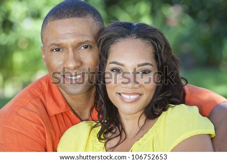 A young African American woman & man couple outside in the summer - stock photo