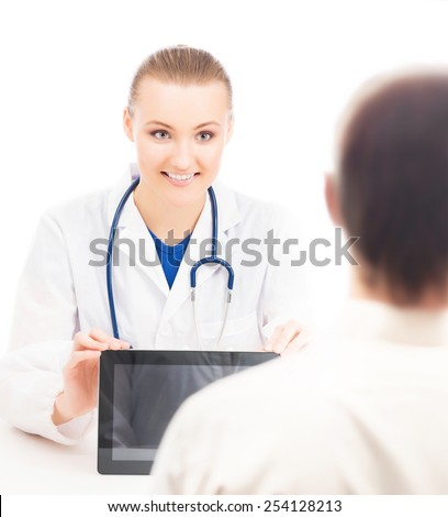 A young and attractive female doctor with a tablet computer showing information to a patient. Image isolated on a white background. - stock photo