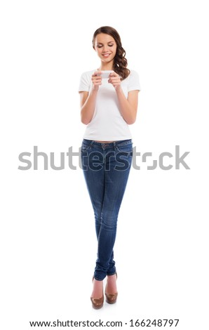 A young and attractive teenage girl with a mobile phone isolated on white - stock photo