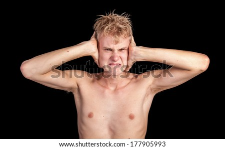A young angry man unwilling to listen during an argument - stock photo