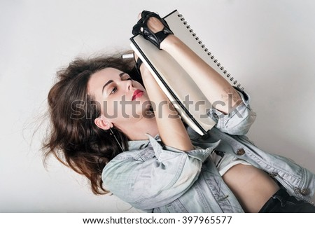 A young artist( writer) draws(writes) lying on the back - stock photo