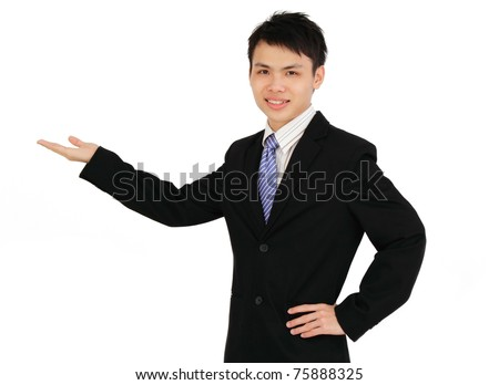 A young Asian businessman presenting - stock photo