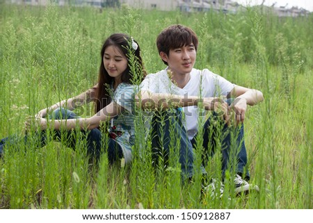 a young Asian couple is playing outdoor - stock photo