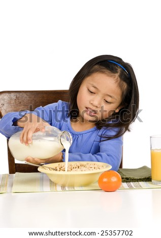 A young Asian Girl eating a healthy Breakfast - stock photo