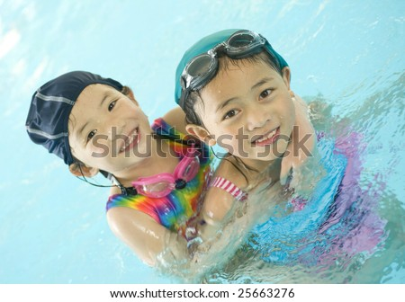A young asian girl in the swimming pool - stock photo