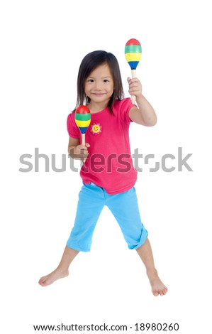 A young asian girl playing with maracas - stock photo