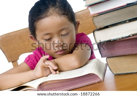 A young asian school girl reading books - stock photo