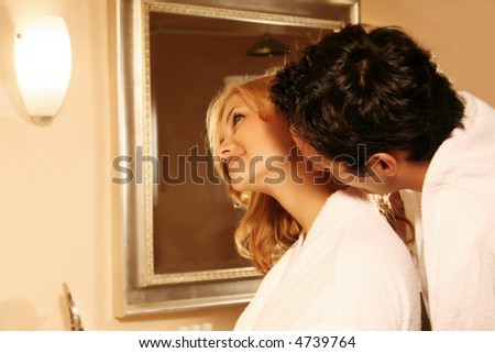 a young attractive couple kissing in the bath - stock photo