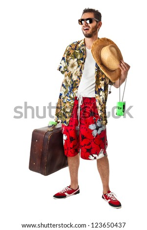 a young, attractive male in a colorful outfit ready to travel as a stereotype tourist - stock photo