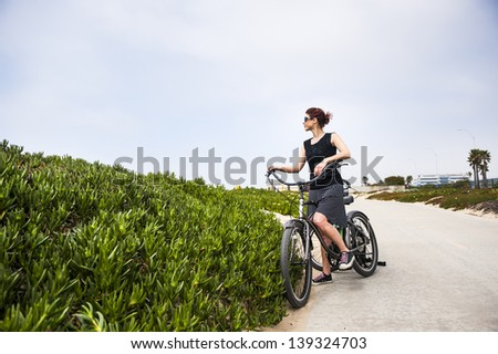 a young attractive woman on a bicycle - stock photo