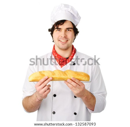 A young baker holds a loaf on a white background - stock photo
