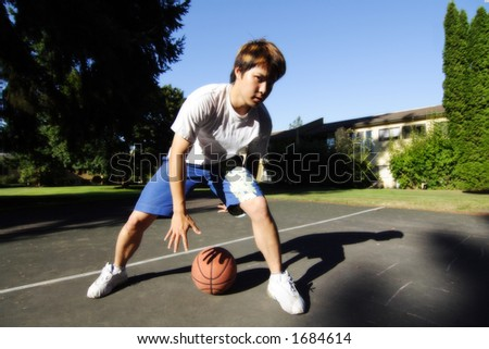 A young basketball player - stock photo