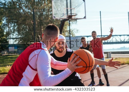 A young basketball player prepares to dribble a ball. - stock photo