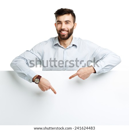 A young bearded man showing blank signboard, isolated over white background - stock photo