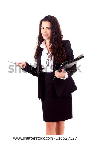 A young beautiful businesswoman presenting your product - stock photo