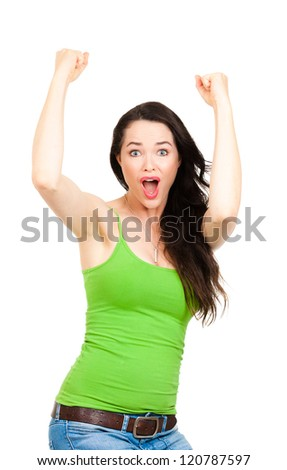 A young beautiful excited woman celebrating success with her hands in the air. Isolated on white - stock photo