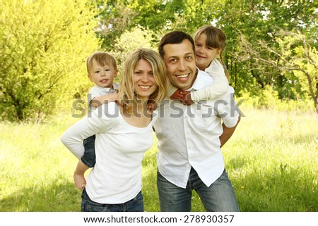 a Young beautiful family with children in nature - stock photo