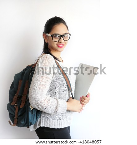 A Young Beautiful Indian College Student Holding Laptop on Isolated White Background - stock photo