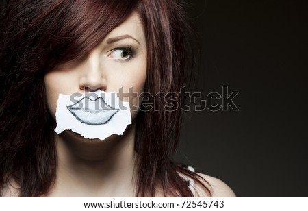 a young beauty with a drawn paper mouth - stock photo
