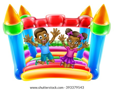 A young black boy and girl having fun jumping on a bouncy castle - stock photo