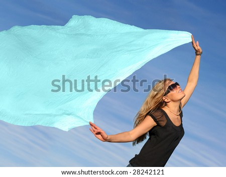 A young blond woman running with a scarf - stock photo