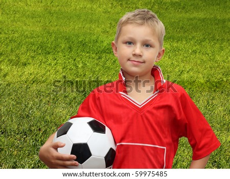 A young boy and soccer ball. - stock photo