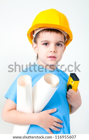 A young boy dreams of becoming a builder guy - stock photo
