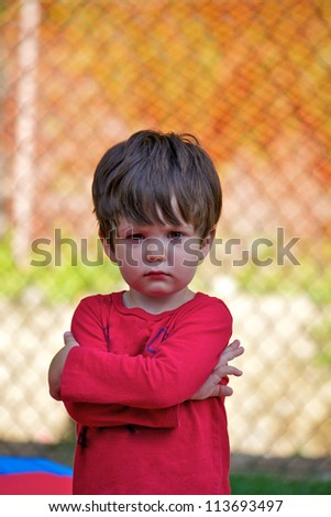 A young boy expressing his emotions - stock photo
