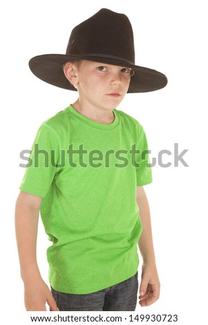 A young boy in a green shirt and a cowboy hat. - stock photo