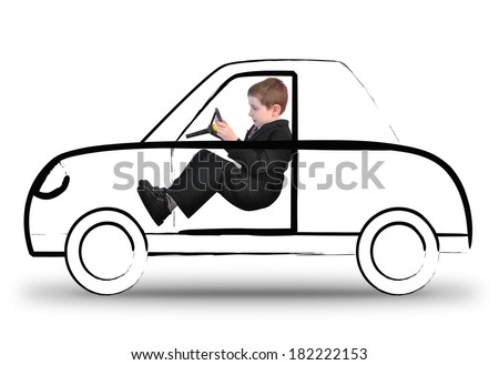 A young boy in a suit is driving an invisible car sketch on a white isolated background. Use it for a travel or imagination concept.  - stock photo