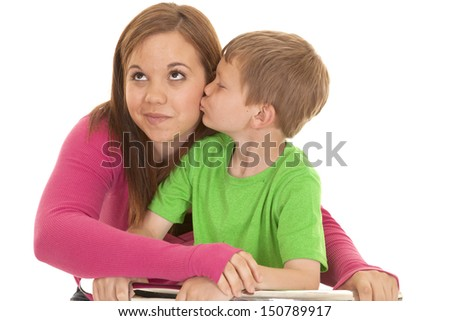 A young boy kisses a girl on the cheek. - stock photo