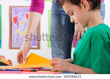 A young boy prepares the card for art lessons - stock photo
