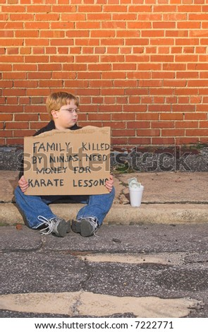 A young boy raising money for karate lessons. - stock photo