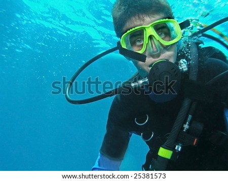 A young boy scuba diver all geared up - stock photo