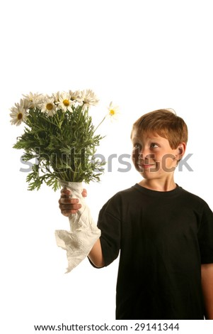 a young boy smiles as he holds a bunch of white daisies isolated on white - stock photo
