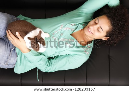 A young, brazilian woman with a Rabbit. - stock photo