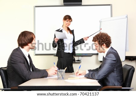 a young business woman making presentation in an office - stock photo