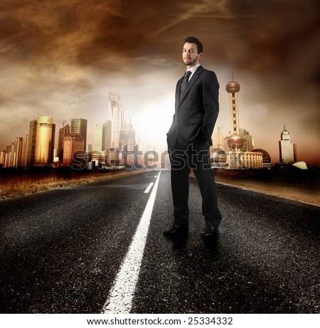 A young businessman on the road of a modern city - stock photo