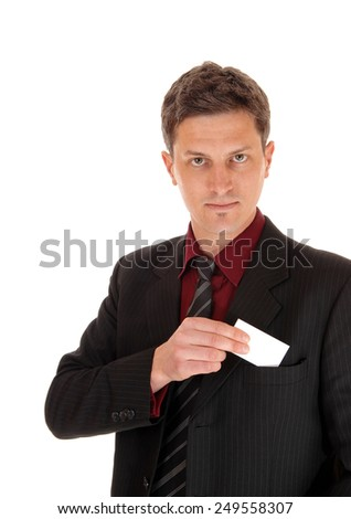 A young businessman potting his business card in his suit pocked, isolated for white background.  - stock photo