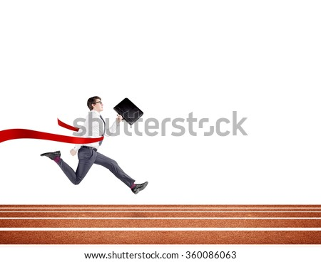 A young businessman running forward on track with a black folder in hand crossing the red finish line. White background. Concept of victory. - stock photo