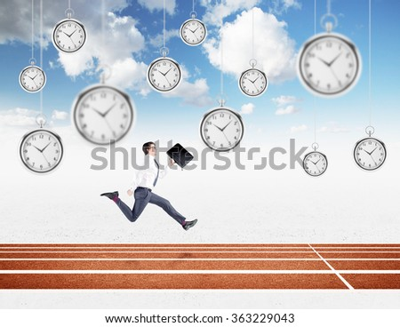 A young businessman running forward with a black folder in hand approaching the finish line. Blue sky at the background, pocket watches hovering from above. Concept of competition. - stock photo