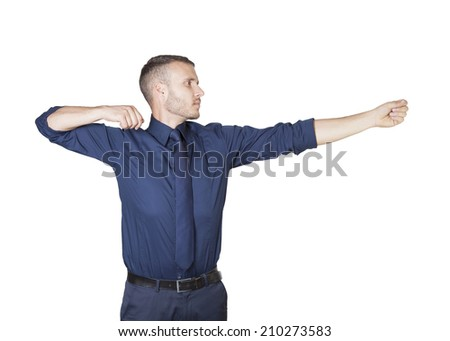 a young businessman shooting isolated on a white background - stock photo
