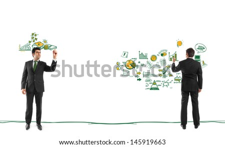 A young businessman sketching ideas for success  - stock photo