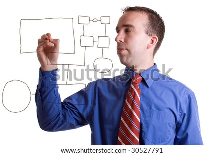 A young businessman using a marker to make an organization chart on some clear glass - stock photo