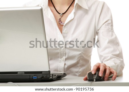 A young businesswoman working on a laptop, isolated on white background - stock photo
