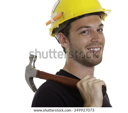 A young carpenter in front of a white background - stock photo