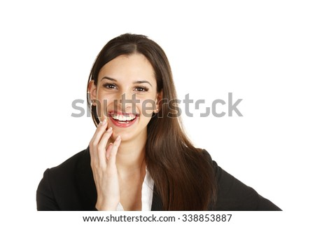A young cheerful woman with her hand to her face. - stock photo