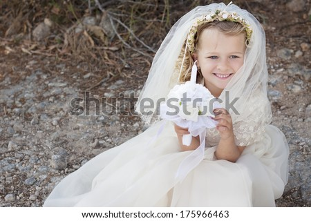 A young child doing her catholic first holy communion - stock photo