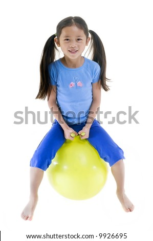 A young child on a bouncing ball. Isolated on white - stock photo