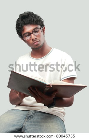 A young college student reads  his note book - stock photo